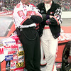 Tony Stewart stands beside his #20 Home Depot NASCAR at TMS in Ft Worth. Kevin green