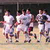 6/10/99--The Mexican semi pro team warms up with laps around the field prior to practice at the Stroh's field in Longview. Kevin green