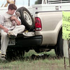 6/25/99---Jeffrey Musick plays with a weimaraner puppy he and his family were selling Friday near the intersection of Gilmer Rd. and Loop 281. A litter of 10 seven-week-old puppies were being sold. bahram mark sobhani