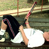 6/23/99-Jonathan Morgan, 10, son of Wayne and Jeanie Morgan of White Oak, relaxes on a bench after a baseball game in Rotary Park.  Jessica Williamson