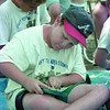 6/17/99-Taylor Latus, 10, makes the scout symbol out of yarn and nails as part of a webelo scout project offered at the East Texas Area Council 1999 Cub Scout Day Camp Thursday afternoon in Longview. Jessica Williamson