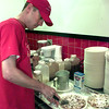 6/23/99-Shawn Hill, one of the owners of The Funnel Cake Factory in the food court at the Longview Mall, cuts and prepares one of the funnel cakes he sells at his shop.  Jessica Williamson