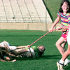 6-27-99  Casey McMicheal right, makes the best she can out of a jump rope game gone haywire.On the ground are Julie Lockhart center and Jenny Boswell at the In God We Trust patriotic rally in Lobo Stadium. Obie LeBlanc