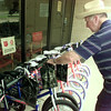 6/28/99---John Hodkinson adjusts a bag on the handlebars of a bike Monday outside the Salvation Army office in Longview. Ten bicycles were donated by Troy Arnonld, with donations from the Laneville Christmas Light Display. 531 bikes have been donated to various agencies in the last four years by the group. bahram mark sobhani