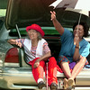 6/19/99---Ethel Jones of Longview, left, and Baby Doll Boyd of Kilgore find a good vantage point for watching the Juneteenth Parade. Jones and Boyd sat in the trunk of the car to keep in the shade and rest their feet. bahram mark sobhani