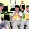 6/2/99---Glenn Sumrall, left, smiles after spelling the last word while Marila Palmer, center, and Kim Russell, right, with LeTourneau University cheer after winning the 1999 Spelling Bee Wednesday afternoon at the Michelob Room in longview. Kevin green
