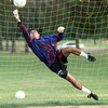 6/10/99---Mexican semi-pro soccer team starting goalie Pastor Suarez reaches to block a shot during practice. Kevin green