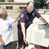 6/10/99---Zetta Jones gives LPD officer Archie Flanery a pat on the back as Flanery unloads a window air conditioning unit donated to Jones at Belaire Manor Apartments. bahram mark sobhani