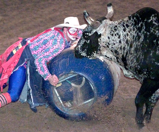 6/10/99Gladewater Round-Up rodeo bull fighter Mike Johnson looks eye to eye with El Nino during rodeo action Thursday night in Gladewater. Kevin green