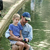 6/17/99---Mike Hawkins and his daughter Annie, 7, of Longview, fish at Teague Park lake during the fishing rodeo. bahram mark sobhani