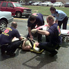 6/22/99-Longview Fire Department Engine 6 crew give aid to Melissa Turner of Longview Tuesday afternoon after a two car collison on N. Fourth Street. Turner was traveling northbound on Fourth Street in her blue Ford t-bird and Judy Thompson of Diana was traveling southbound in her beige Mazda pickup truck when Thompson lost control of her vehicle and collided with Turner.  Both women were taken to Good Shepherd Medical Center to receive a routine checkup. Jessica Williamson