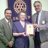 6/7/99---Mike Verucchi, pres of the LGV downtown rotary club, left, and committee member of the citzen of the year leGrande Northcutt, rigth, present Kandie Wilson, center, as the 1999 Citizen of the Year during a luncheon Tuesday afternoon at Pinecrest CC in Longview. Kevin green
