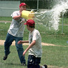 6/17/99-Josh Hall, 10, a webelo at the East Texas Area Council 1999 Cub Scout Day Camp, dodges getting splashed with a bucket of water from camp asssistant Roger Hall, 17, Thursday afternoon in Longview.  Jessica Williamson