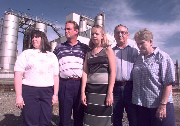 6/10/99-(left to right) Terri Seiber stands with her husband, Bobby, their daughter Leslie, Joe Sieber, Bobby's father, and Joe's wife, Mary.   Joe retired from Stroh's after 30 years and his son Bobby has worked their for 15 years. Jessica Williamson