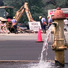 6/1/99---City of Longview workers repair a broken water amin at the intersection of High St. and South Tuesday morning while water is released from a hydrant in Longview. Kevin green