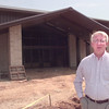 6/21/99-The Rev. Johnson stands in front of Fellowship Bible Church's new building. Kevin green