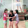6/30/99--Alma Cortez, 13, sprays water on her sisters and a cousin, Nora Cortez, 7, left, Viviana Perez, 7, center, and Marisela Cortez, 6, right,  Wednesday afternoon in the 500 BLK. of Birdsong in Longview.Kevin green