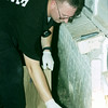 6/8/99---Dan Reigstad, Physical Evidence Specialist for Longview Police Department, collects a gun allegedly used in a homicide Tuesday night at 1206 12th St. bahram mark sobhani