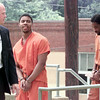6/2/99---Deputy U.S. Marshall Bobby Freeman, left, leads Daymon Smith and Kenneth A. Tatum, right, out of the U.S. District Courthouse in Marshall following their arraignment. Smith and Tatum plead not guilty in a series of bank robberies and slayings earlier this year. bahram mark sobhani