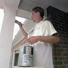 6/15/99-Gary Webb, employee of Bobby Mowery Paint Company in Longview, puts some finishing touches on the paint job of a house in Hunters Creek Subdivision. This house will be one of the houses open to tour on the Parade of Homes.  Jessica Williamson