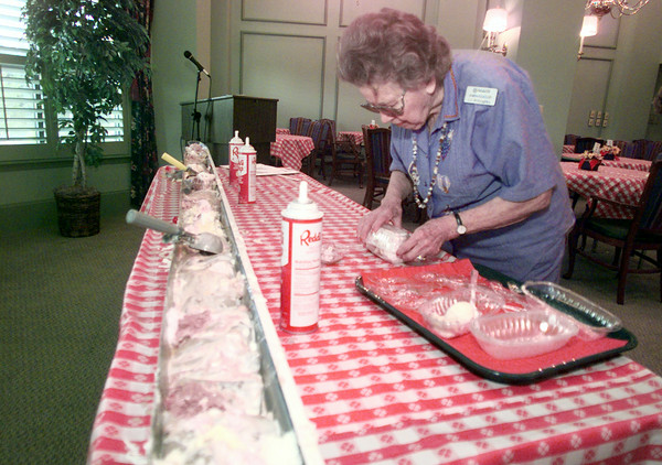 6/3/99---Buckner Westminster Retirement Center resident Lil Willoughby packs up a banana split to go Thursday at the center. The retirement center celebrated their third year with a giant banana split and other entertainment. bahram mark sobhani