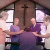 6/10/99---Members of the Order of St. Luke, from left, Betty Boone, Jean Ritchie, Bill and Jean White, lay on hands and pray for the healing of Jeff Richardson's gingivitis inside the St. Michael's and All Angels' Episcopal Church. bahram mark sobhani