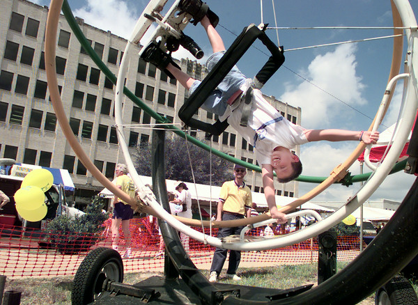 6/5/99---Ben Connell, 9, of Longview, takes a wild ride on the Orbitron at KidsFest. bahram mark sobhani