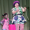 5/10/99---Retta Roberson as Giggles the Clown, right, gets a little help from G. K. Foster kindergartner LaToria Williams, left, during a magic trick at a show Monday afternoon at G. K. Foster in Longview. Kevin green