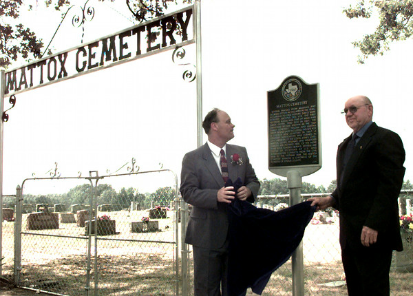 5-16-99  Foster Middle School Teacher  James Oliver left and D.N. East dedicate a Texas  Historical Commission marker at the Mattox Cemetery in east Upshur County. Obie LeBlanc