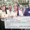5/26/99---Sams store amnager Jack Byers, right, presents a check for 13,313.00 dollars to Henry Yarbrough, left, Wynston Carter, center, and Chuck Wilerson, right, with the Shriners Thursday morning at Sams Club in Longview. Kevin green