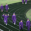 5/28/99--The Hallsville High School class of 1999 make thier way to be seated while one raises the roof as the ceremony begins Friday evening at the HHS football stadium in Hallville. Kevin green