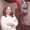 """5/15/99---Future Akins stands next to the art piece """"Passion and Desire Dance a Slow Death,"""" which she co-authored with Chase Yarbrough at the Longview Museum of Fine Arts. The piece won third place in the museum's annual Invitational Exhibition. bahram mark sobhani"""