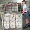 5/10/99---U.S. Post office letter carrier Russell Ward prepares to load food onto to a truck after the McCann post office collected 342 boxes of food for the drive Monday morning in Longview. KEvin green