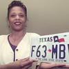5/21/99---Charlotte Johnson holds a Texas state license plate at the county tax office Friday. New license plates have a holographic image embedded in them. bahram mark sobhani
