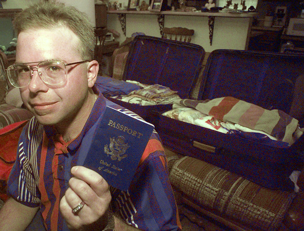 5/11/99---White Oak resident Steve Semety sits, passport in hand, in his living room as he finishes packing for his trip today to Macedonia. Semety is leaving today for Macedonia to help with the Kosovan refugees. bahram mark sobhani