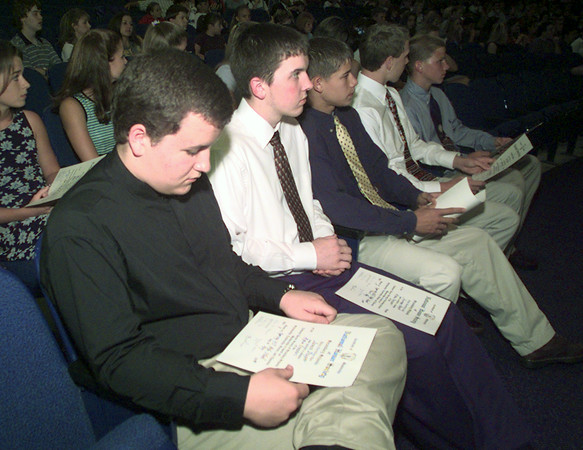 5/17/99---Spring Hill High School student James Draper looks over the certificate he received Monday during the school's awards assembly. The certificate is for National Honor Society. bahram mark sobhani