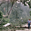 5/4/99---Entex leak surveyor Carl Auvil walks down Green Hills Dr. in Kilgore, which was hit hard by storms, which downed trees and powerlines Tuesday. bahram mark sobhani