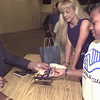 5/4/99---Keuntra Johnson, 11, receives an autographed photo from Earl Campbell at the Steak and Burger dinner Tuesday night at the Maude Cobb Center.