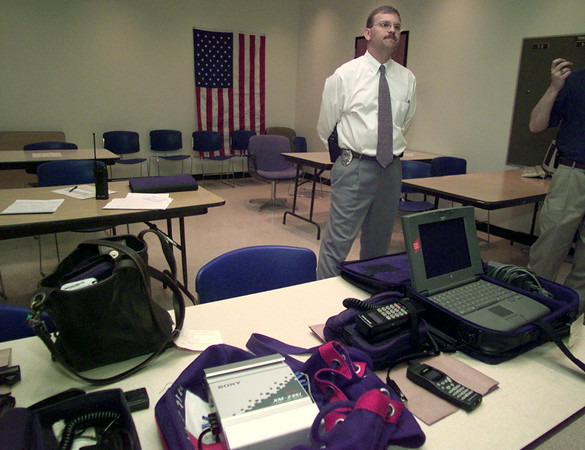 5/17/99---Longview police detective John Ray speaks about the recovered stolen items Monday at the police station. bahram mark sobhani