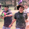 5/4/99---Christopher Lockhart, left, chases Jaclyn Harvey, right, both are sophmores, with a water gun  during a field day for Maranatha Christian High School Tuesday afternoon at Teague Park in Longview. Kevin green