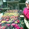 5/20/99---High School gargener Josh Emerson waters plants Thursday afternoon at Emerald Gardens in Longview. Kevin green