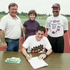 5/19/99---Longview High School runner Joe Kendrick signs a track scholarship to Oklahoma Baptist University on the school track Tuesday. Behind him are his parents, Jim and Shawn and LHS track coach Curtis Jones, right. bahram mark sobhani