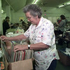 5/6/99---Sarah Turner of Longview searches for an Elvis record at the Senior Recreation Center garage sale Thursday. The sale continues today from 9 a.m. to 3 p.m. bahram mark sobhani