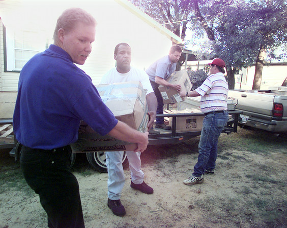 5/13/99---HiWay 80 Rescue Mission residents Ricci Boss, left, Billy Jefferson, second from left, and David Bowen, right, help James Pitre, in trailer, unload nearly 3500 pounds of donated to food and clothing at the mission. Pitre is from Oakland Heights Baptist Church. bahram mark sobhani