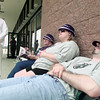 5/18/99---Die hard Star Wars fans, from left, Johnnie Cavness, Theresa Stinson, and Michelle and John Griffith, wait outside Carmike Theater in Longview Tuesday morning for the 12:01 a.m. Wednesday showing of the Phantom Menace. Many people camped out Monday night for the first tickets which went on sale Tuesday morning, but only a few remained to wait the additional 15 hours until the movie started.