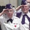 5/29/99---Violet Hammett, left, and Billie Knight, both veterans of WWII and members of the Northeast Texas Women Veterans, salute during the playing of taps at the end of Memorial Day services Saturday on the Gregg County Courthouse lawn. bahram mark sobhani