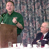 5/25/99---Henry Rogers, left, with Interstate Batteries of Dallas, speaks during the Mayor's Prayer Breakfast while Frank Hamilton, right, of Longview looks on Tuesday morning at Best Western on Estes Parkway in Longivew. Kevin Green