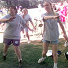 5/8/99---Nina Hrynewyh, left, and Andrea Bieciuk, right, with Strategic Communications of Longview, warm up proir to walking during the 99 March of Dimes Walk America Saturday morning at Teague Park in Longview. Kevin green