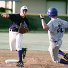 5/12/99---Spring Hill's Matt Wintters (3) throws the double-play ball as Hooks' Lance Waller starts his slide. bahram mark sobhani