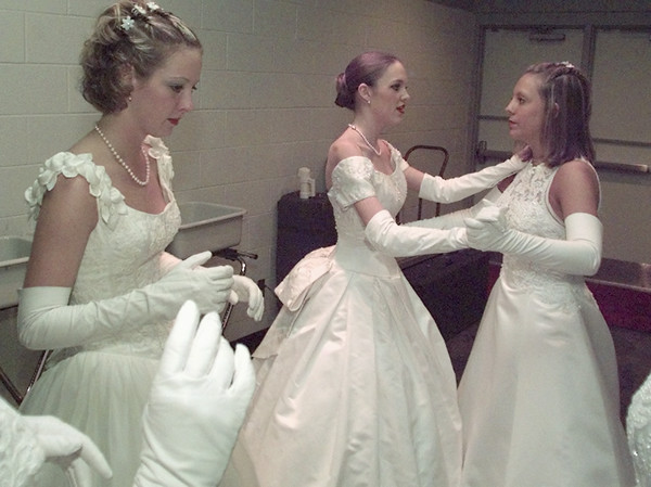 5/29/99---Lauren Gantt, and Katie Post, right, practice dancing while Keyea Webster, left, concentrates on her presentation before they are introduced Saturday at the Longfellow's Debutante Ball at the Maude Cobb Convention and Activity Center. bahram mark sobhani